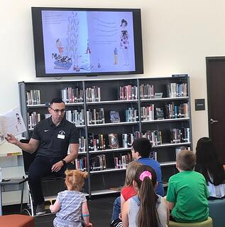 Seguin ISD Dr. Gutierrez reading to children