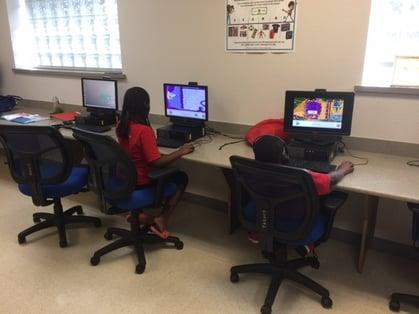 Tackle Summer Slide kids working